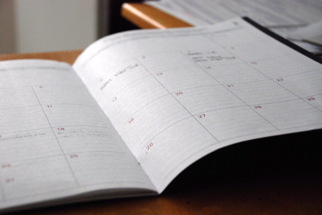 Notebook ledger showing dates and scheduled appointments